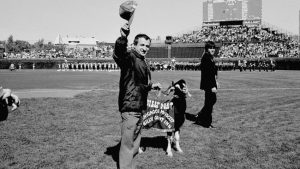 FILE - In this Oct. 2, 1984 file photo, Sam Sianis, owner of the Billy Goat Tavern in Chicago, acknowledges the crowd along with his goat prior to a National League playoff game between the San Diego Padres and the Cubs in Chicago. Cubs fans Erik Williams and Brad Knaub are hoping to exorcise the Curse of the Billy Goat this postseason by, well, slaughtering one of their own goats. They own a company that produces sausage and other food from locally sourced meats. Now, perhaps this entire endeavor is another crackpot scheme by Cubs fans to help deliver a World Series title. But research has proven that superstitions actually do help athletes perform better. (AP Photo)
